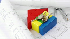 Close-up of plans, model house and keys turning Stock Footage