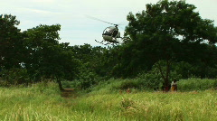 Helicopter lands beside truck Stock Footage