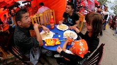 Mongolians eat khuushuur during Naadam Festival, Mongolia Stock Footage