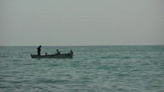 Fishermen sitting in a boat Stock Footage
