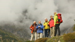 seniors hiking with female guide - stock footage