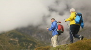 Two senior hikers taking a break Stock Footage