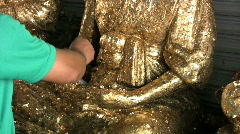 Putting Gold Leaf On Buddha Statue Stock Footage