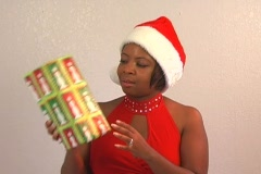 Beautiful Woman Shakes a Christmas Gift (1) Stock Footage