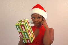 Beautiful Woman Shakes a Christmas Gift (3) Stock Footage