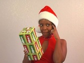 Beautiful Woman Shakes a Christmas Gift (3) Stock Footage