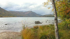 Autumn lake with moody sky Stock Footage