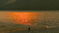Smoky red sun reflection on lake, surreal Stock Footage
