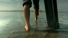 Woman walking with bare feet on wetlands Stock Footage