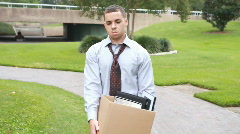 Jobless man walking to bench follow Stock Footage