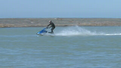 A  jet ski traverses a corner in slow motion Stock Footage