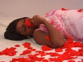 Beautiful Woman Lying Amidst Rose Petals (2) Stock Footage