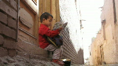 Uyghur girl studying school book - stock footage