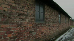 Auschwitz Birkenau barrak close pan round Stock Footage