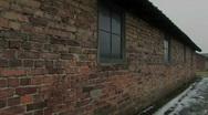 Auschwitz Birkenau barrak close pan round Stock Footage