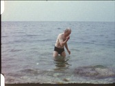 Grandpa after swimming (vintage 8 mm amateur film) Stock Footage