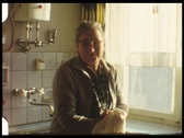 Grandma in kitchen (vintage 8 mm amateur film) Stock Footage