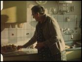Grandma in kitchen (vintage 8 mm amateur film) Stock Footage