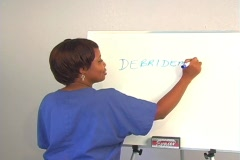 "Beautiful Nurse Writes ""Debridement"" on a White Board Stock Footage"