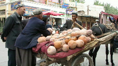 Traditional vegitable seller in Kashgar, China Stock Footage