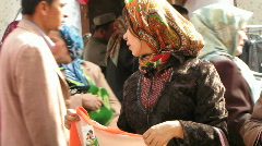 bazaar Kashgar, China,  women discuss purchase - stock footage