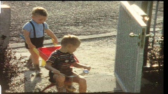 Boys with pushcart and trike (vintage 8 mm amateur film Stock Footage