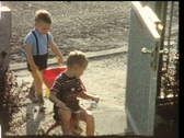 Stock Video Footage of Boys with pushcart and trike (vintage 8 mm amateur film