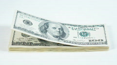 Dollars blowing away - stock footage