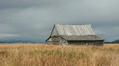 Old Barn in valley pan P HD 3056 Stock Footage