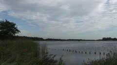 Lake Cloudy Blue Sky - Pan Stock Footage