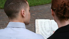 Looking over their shoulder bible Stock Footage