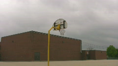 Back of school with zoomin to basketball net Stock Footage