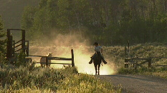 Cowgirls Roundup Horses at Sunset 11 59.94 - stock footage