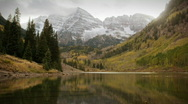 (1119) Autumn Early Snow Storm - Maroon Bells Colorado Mountains and Aspens Stock Footage