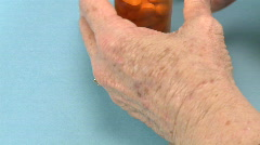 Woman taking two pills Stock Footage