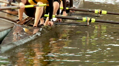 Crew Team Sit in Boat on Water - stock footage