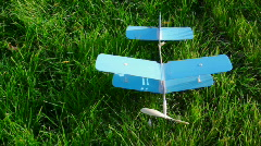 Toy aircraft on green grass Stock Footage