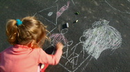 Stock Video Footage of little girl chalking on asphalt