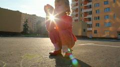 little girl chalking on asphalt - stock footage