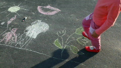 little girl walking on drawing on asphalt - stock footage