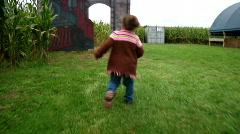 Girl Runs into Corn Maze 982 Stock Footage