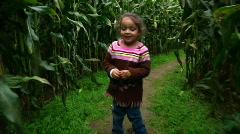 Girl Walks Thru Corn Maze 987 Stock Footage