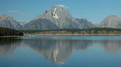 Grand Teton over lake marina P HD 3145 Stock Footage