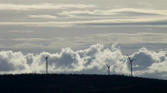 Wind turbine turning in front of moving clouds Stock Footage