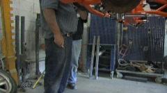 Mechanics working on auto Stock Footage
