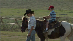 Child on Pony Ride Horse 3 59.94 Stock Footage