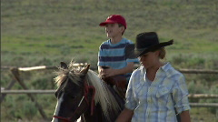 Child on Pony Ride Horse 5 59.94 - stock footage