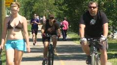 Sports and fitness, bike path, people walking and riding, #2 Stock Footage
