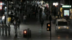 Trafic light / people walking on a Crowded street at night  Stock Footage