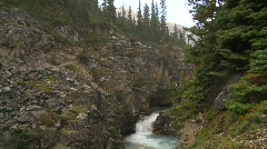 Sports and fitness, hikers on steep rainy trail above gorge Stock Footage
